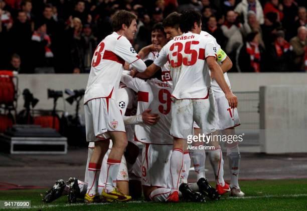 Pavel Pogrebnyak of Stuttgart celebrates his team's third goal with team mates during the UEFA Champions League Group G match between VfB Stuttgart...