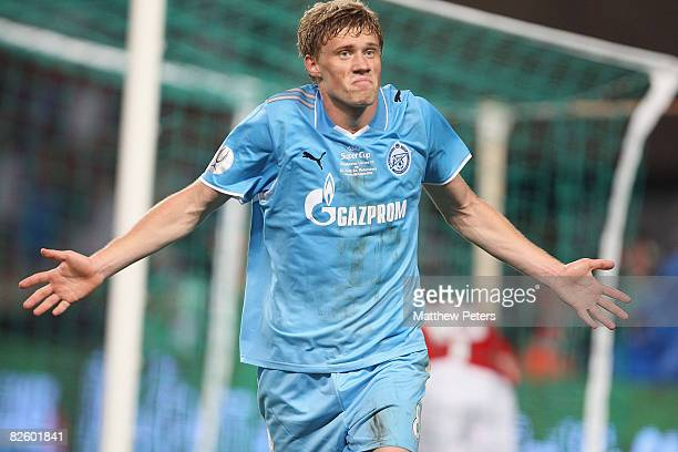 Pavel Pogrebnyak of Zenit St Petersburg celebrates scoring their first goal during the UEFA Supercup match between Manchester United and Zenit St...