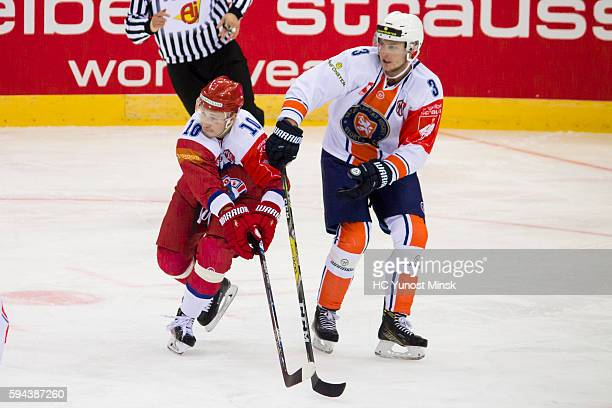 Pavel Razvadovski of Yunost Minsk against Oliver Bohm of Vaxjo Lakers during the 2nd period of the Champions Hockey League group stage game between...