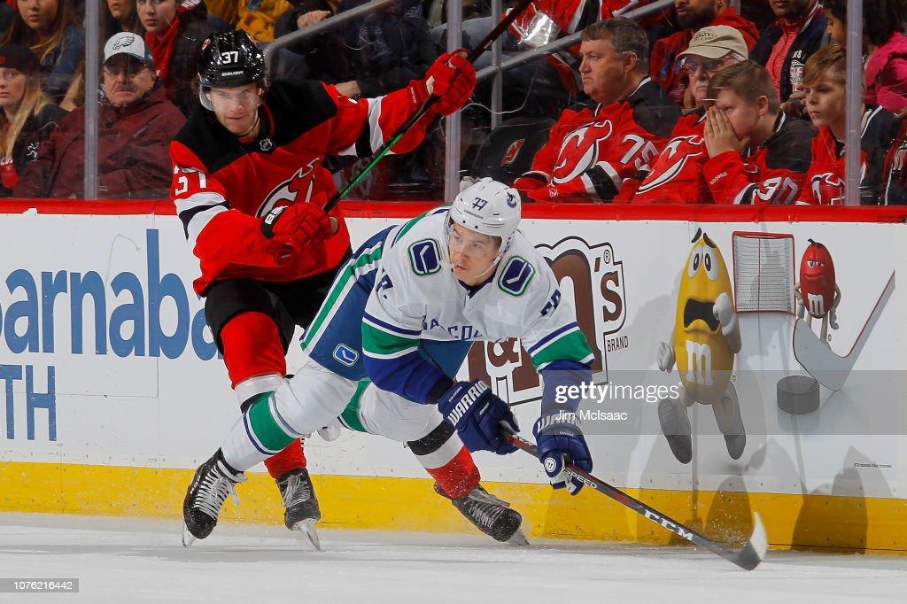 Pavel Zacha of the New Jersey Devils checks Nikolay Goldobin of the ... bf78ca174