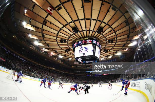 Pavel Zacha of the New Jersey Devils faces off against JT Miller of the New York Rangers at Madison Square Garden on December 9 2017 in New York City...