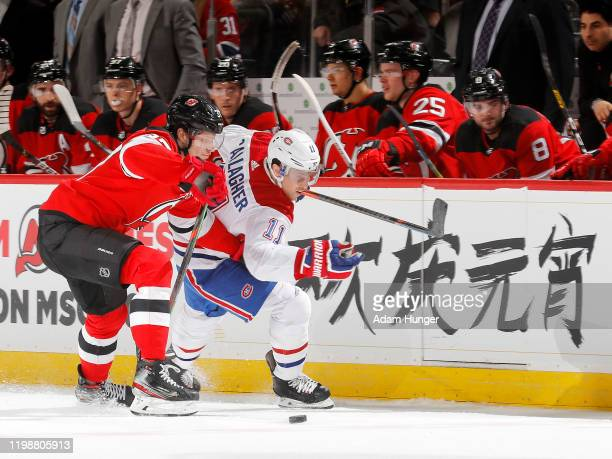 Pavel Zacha of the New Jersey Devils keeps Brendan Gallagher of the Montreal Canadiens from the puck during the second period on February 4 2020 in...