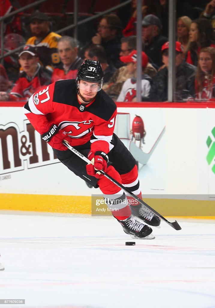 Pavel Zacha #37 of the New Jersey Devils plays the puck against the Boston Bruins during the game at Prudential Center on November 22, 2017 in Newark, New Jersey.