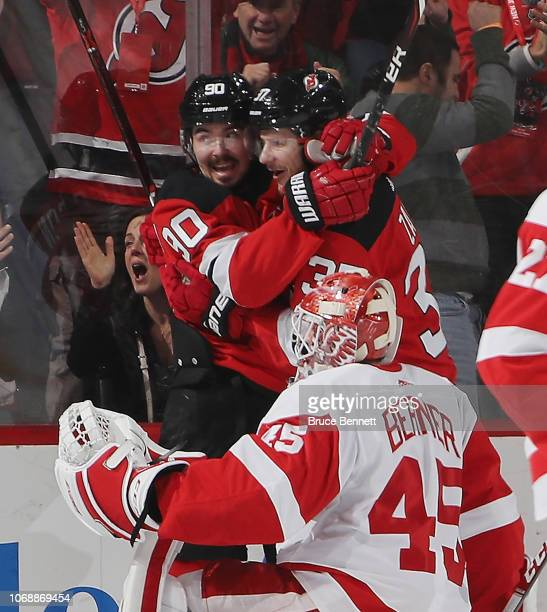 Pavel Zacha of the New Jersey Devils scores at 11:35 of the first period against Jonathan Bernier of the Detroit Red Wings and is joined by Marcus...