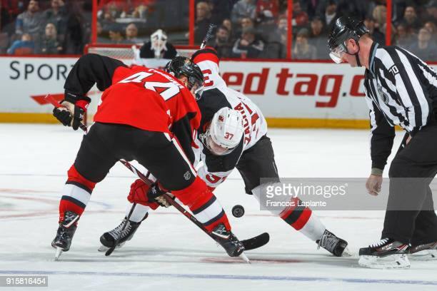 Pavel Zacha of the New Jersey Devils takes a faceoff against JeanGabriel Pageau of the Ottawa Senators at Canadian Tire Centre on February 7 2018 in...