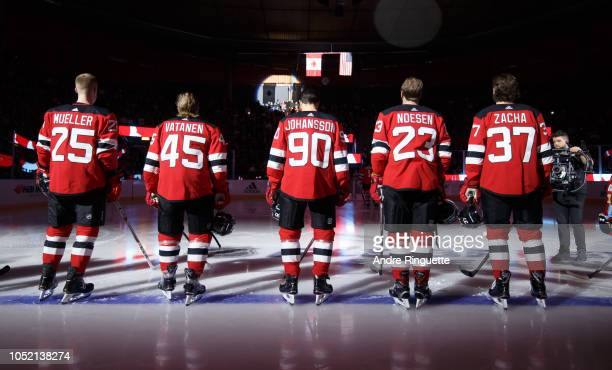 Pavel Zacha Stefan Noesen Marcus Johansson Sami Vatanen and Mirco Mueller of the New Jersey Devils stand at attention during the singing of the...