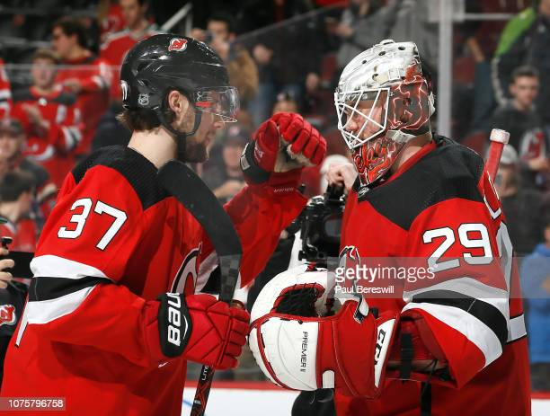 Pavel Zacha who scored the game winning goal celebrates with goalie Mackenzie Blackwood of the New Jersey Devils after Blackwood just got his first...