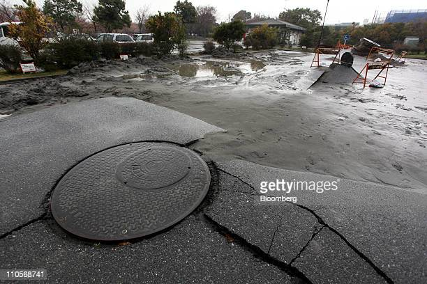 Pavement around a manhole is cracked from the recent earthquake in Urayasu Japan on Tuesday March 22 2011 The quake caused water to bubble up from...
