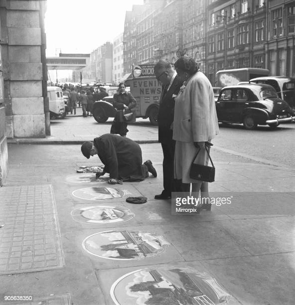 Pavement artist at work at Victoria Station 21st May 1954