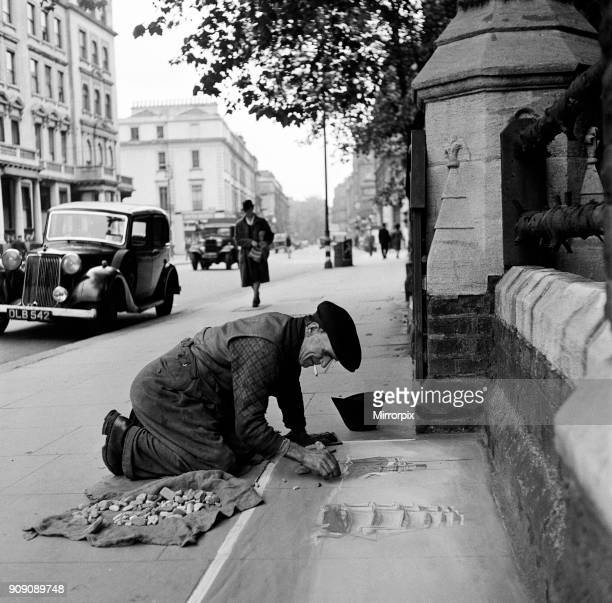 Pavement Artist at work in Gloucester Road London 1946