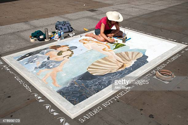 Pavement artist painting The Birth of Venus by Botticelli London UK