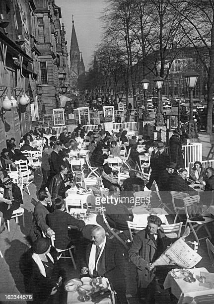 Pavement cafe on the Kurfurstendamm in Berlin, on a spring day, circa 1935.