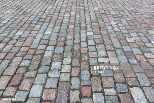 pavement of granite in the town street - cobblestone stock pictures, royalty-free photos & images