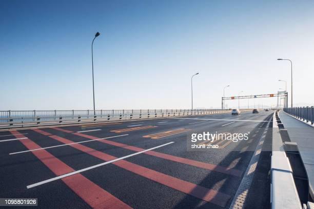 pavement on bridge - dalian stock photos and pictures