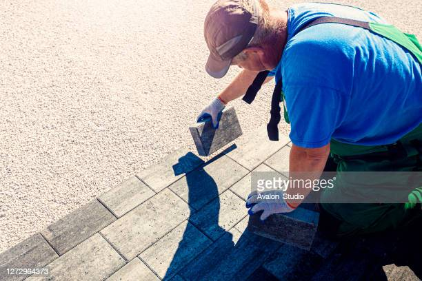 paver at work - elevated walkway stock pictures, royalty-free photos & images