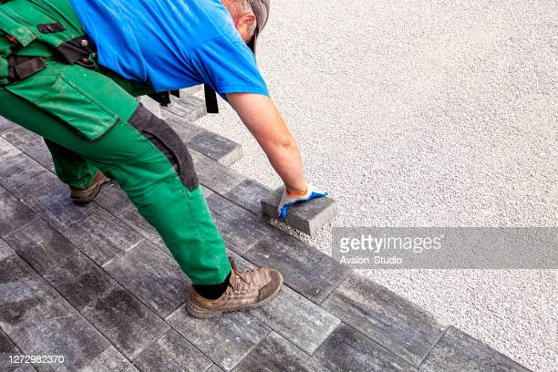 paver at work - paver driveway stock pictures, royalty-free photos & images