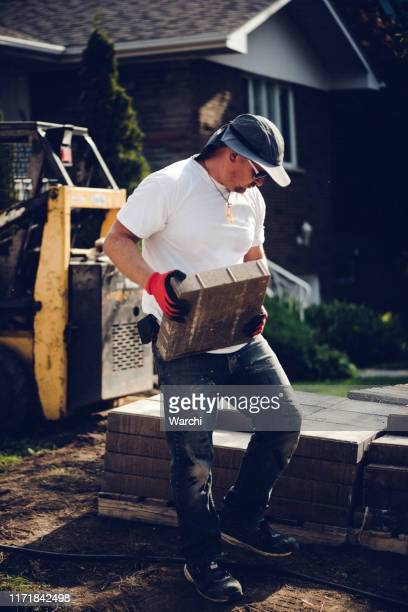 paver renovating the driveway - paver driveway stock pictures, royalty-free photos & images