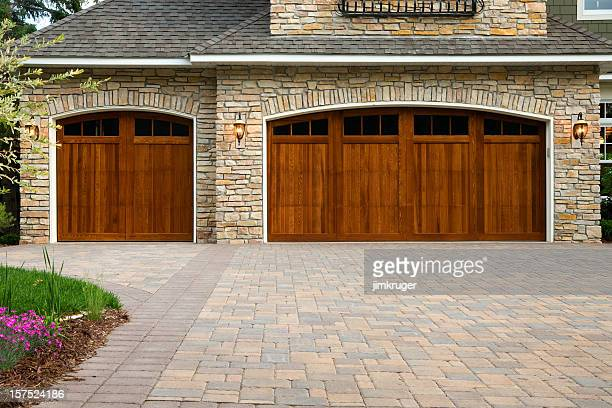pavers, custom doors, and stone on upscale home. - paving stone stock pictures, royalty-free photos & images