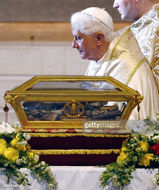 Pope Benedict XVI passes in front of the remains of St Augustine during a visit to the northern Italy city of Pavia 22 April 2007 The Pope himself a...