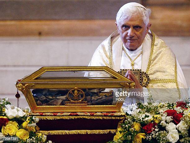 Pope Benedict XVI prays before the remains of St Augustine during a visit to the northern Italy city of Pavia 22 April 2007 The Pope himself a major...