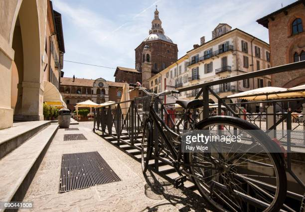 Pavia town square in Italy from behind a cycle.