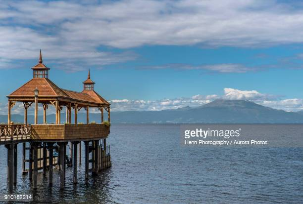 Pavilion at end of pier at Llanquihue Lake with view of volcano Osorno, Frutillar, Llanquihue province, Chile