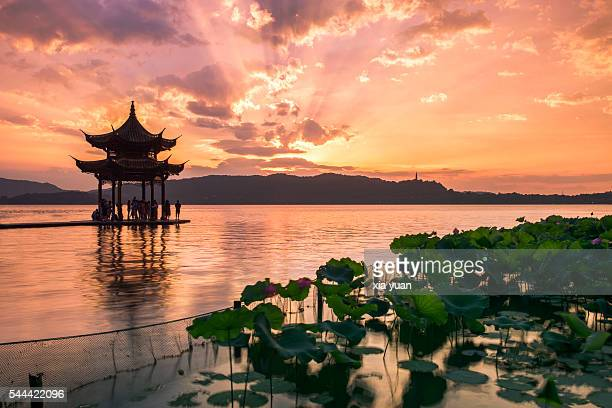 Pavilion on the West lake against sunset in the summer,Hangzhou,China