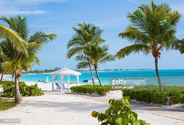 Pavillon sunbeds coconut palm trees and the beach of luxury Resort and Hotel Cape Santa Maria which is having one of the Bahamas´ best beaches with...