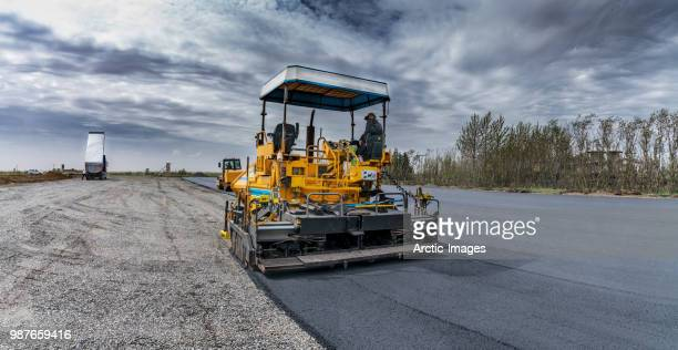 paving a new road, iceland - baumaschine stock-fotos und bilder