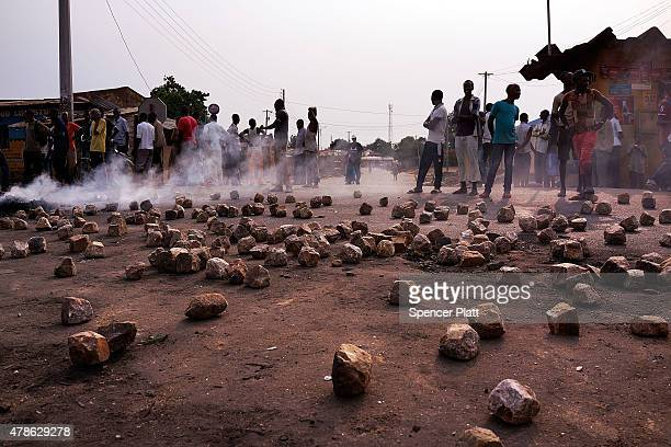 Paving stones and a tire fire are viewed during protests against the governing party on June 26, 2015 in Bujumbura, Burundi. The head of Burundi's...