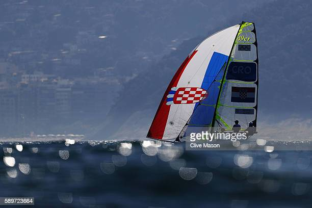 Pavle Kostov of Croatia and Petar Cupac of Croatia compete in the Men's 49ers class on Day 10 of the Rio 2016 Olympic Games at the Marina da Gloria...