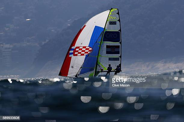 Pavle Kostov of Croatia and Petar Cupac of Croatia compete in the Men's 49er class on Day 10 of the Rio 2016 Olympic Games at the Marina da Gloria on...