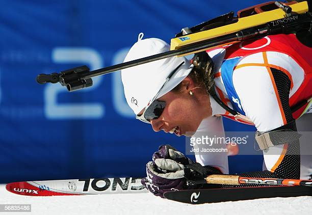 Pavlina Filipova of Bulgaria collapses at the finish line after competing in the Womens Biathlon 15km Individual Final on Day 3 of the 2006 Turin...