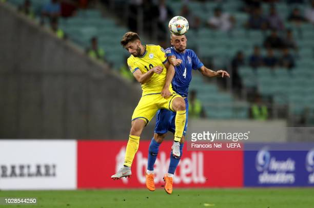Pavlo Pashayev of Azerbaijan wins a header over Arber Zeneli during the UEFA Nations League D group four match between Azerbaijan and Kosovo at Baku...
