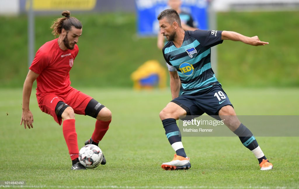 Pavlos Laskaris of Aiginiakos FC and Vedad Ibisevic of Hertha BSC during the test test match between Hertha BSC and Aiginiakos FC at the Athletic Area Schladming on august 10, 2018 in Schladming, Austria.