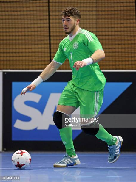 Pavlos Wiegels of Germany runs with the ball during the Futsal international friendly match between Germany and Czech Republic at Ballsport Arena on...