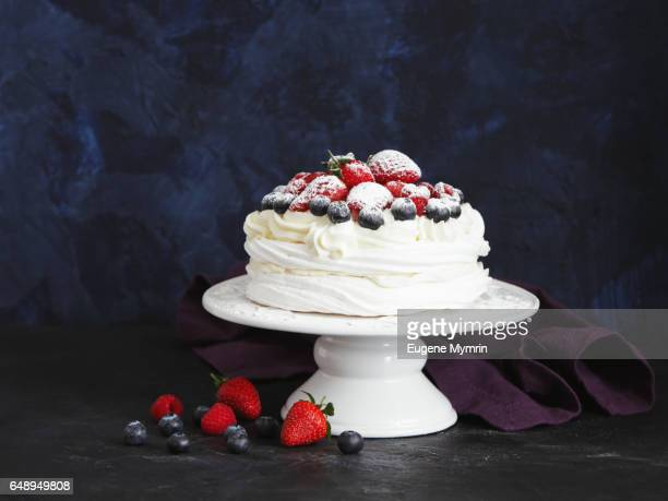 pavlova cake with berries - meringue stock pictures, royalty-free photos & images