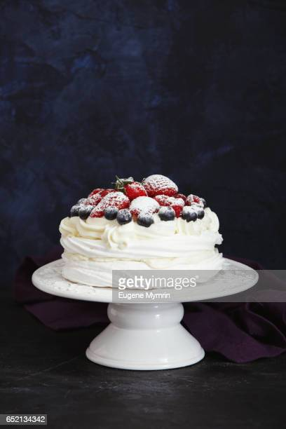 pavlova dessert with berries - cakestand stock pictures, royalty-free photos & images