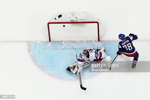 Pavol Demitra of Slovakia scores the game-winning goal against Ilya Bryzgalov of Russia during the ice hockey men's preliminary game between Slovakia...