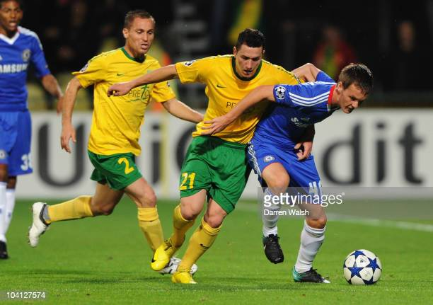 Pavol Poliacek of MSK Zilina battles with Josh McEachran of Chelsea during the UEFA Champions League Group F match between MSK Zilina and Chelsea at...