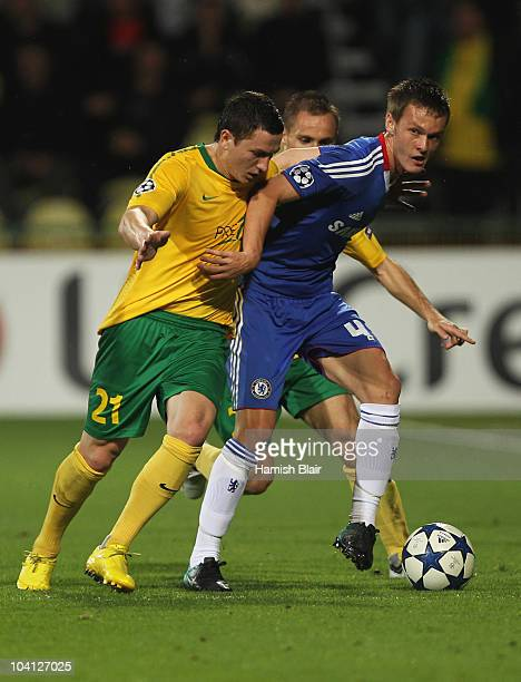 Pavol Poliacekof MSK Zilina battles with Josh McEachran of Chelsea during the UEFA Champions League Group F match between MSK Zilina and Chelsea at...