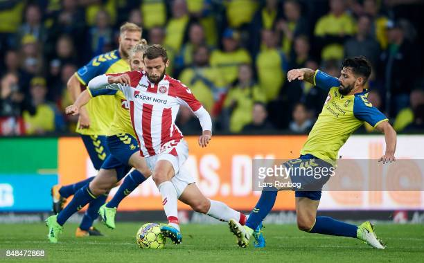 Pavol Safranko of AaB Aalborg and Anthony Jung of Brondby IF compete for the ball during the Danish Alka Superliga match between Brondby IF and AaB...