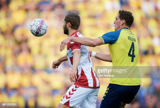Pavol Safranko of AaB Aalborg and Benedikt Rocker of Brondby IF compete for the ball during the Danish Alka Superliga match between Brondby IF and...