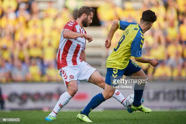 Pavol Safranko of AaB Aalborg and Besar Halimi of Brondby IF compete for the ball during the Danish Alka Superliga match between Brondby IF and AaB...