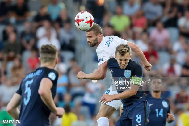 Pavol Safranko of Slovakia and James WardProwse of England battle for the ball during the 2017 UEFA European Under21 Championship match between...
