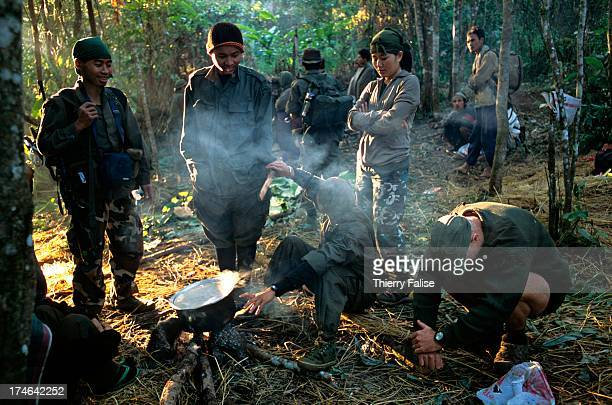 Paw Htoo a Karen nurse and a founding member of the Free Burma Rangers is talking with other members of an expedition while waiting for the rice to...