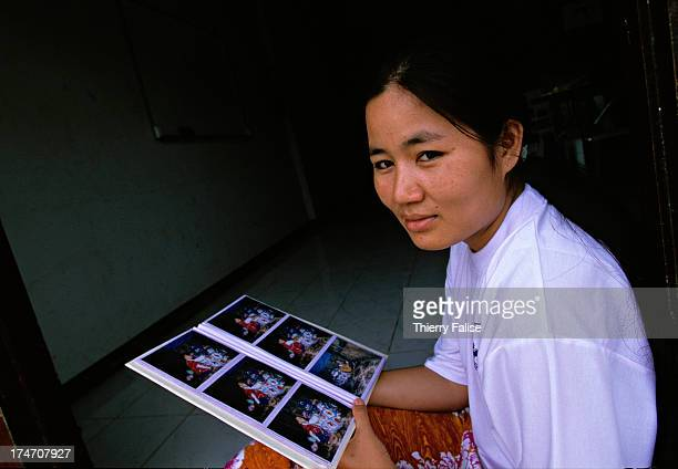Paw Htoo a Karen nurse and a founding member of the Free Burma Rangers shows pictures of her 12 yearold boy who is living far away with her...