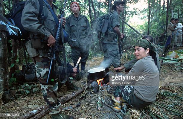 Paw Htoo a Karen nurse and member of the Free Burma Rangers sits near a morning fire