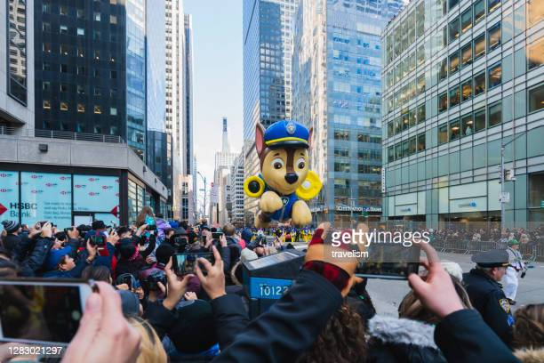 paw patrol balloon flies in the macy's thanksgiving day parade. - paw patrol stock pictures, royalty-free photos & images