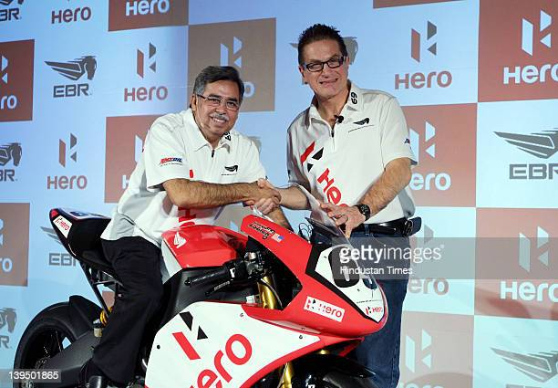 Pawan Munjal MD CEO of Hero MotoCorp poses with Erik FBuell Chairman CTO of EBR poses with EBR 1190RS bike during the press conference on February 22...